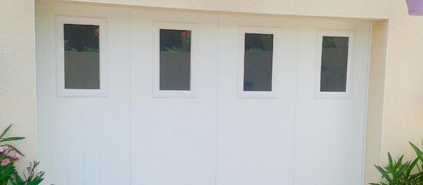 Banniere produit Portes de garage sectionnelles latérales
